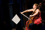 Alisa Weilerstein, cello, performs in the Spanish Courtyard at Caramoor  in Katonah, New York.