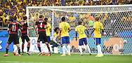 Brazil concede the first goal during the 2014 FIFA World Cup match at Mineir&atilde;o, Belo Horizonte<br /> Picture by Stefano Gnech/Focus Images Ltd +39 333 1641678<br /> 08/07/2014