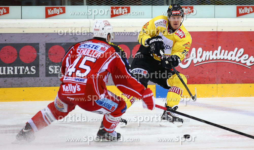 03.01.2014, Albert Schultz Eishalle, Wien, AUT, EBEL, UPC Vienna Capitals vs EC KAC, 63. Runde, im Bild David Schuller, (EC KAC, #45) und Marcus Olsson, (UPC Vienna Capitals, #20) // during the Erste Bank Icehockey League 63rd Round match between UPC Vienna Capitals and EC KAC at the Albert Schultz Ice Arena, Vienna, Austria on 2014/01/03. EXPA Pictures © 2014, PhotoCredit: EXPA/ Thomas Haumer