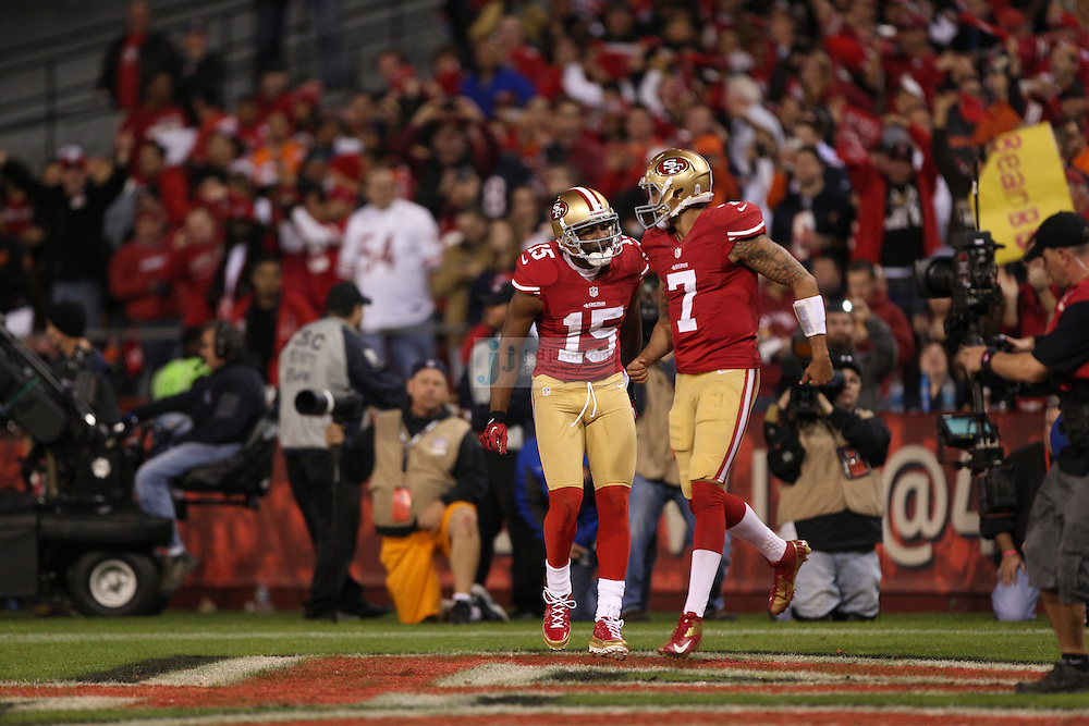 San Francisco 49ers wide receiver Michael Crabtree (15) celebrates after scoring a touchdown with San Francisco 49ers quarterback Colin Kaepernick (7) against the Chicago Bears, during an NFL game on Monday Nov. 19, 2012 in San Francisco, CA.  (photo by Jed Jacobsohn)