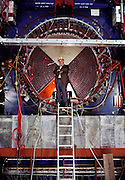 Burton Richter (b.1931), Director of the Stanford Linear Accelerator Center (SLAC), photographed during the construction of the Stanford Linear Collider in 1986. Richter won the 1976 Nobel Prize for Physics, following his discovery of the Psi- particle at the SLAC in 1974. The Prize was shared with Sam Ting of Brookhaven National Laboratory. The discovery of the Psi- particle also implied the existence of two new quarks, Charm and anti- Charm. Richter has been at SLAC since 1964, having also designed the PEP positron-electron storage ring at Stanford. Richter became Director of SLAC in 1984, and now oversees projects such as the Stanford Linear Positron-Electron Collider. MODEL RELEASED. Detector 4 SLC in CEH. MODEL RELEASED.