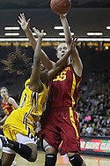 December 09 2010: Iowa guard Kachine Alexander (21) puts up a shot as Iowa St. center Anna Prins (55) defends during the first half of their NCAA basketball game at Carver-Hawkeye Arena in Iowa City, Iowa on December 9, 2010. Iowa defeated Iowa State 62-40 in the Hy-Vee Cy-Hawk Series rivalry game.