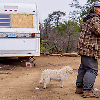 050515       Cable Hoover<br /> <br /> Claudia Sanders checks the weather as she stands outside a newly donated trailer Tuesday in Candy Kitchen. Sanders now lives in the trailer that was brought by Cibola County Sheriff Tony Mace.