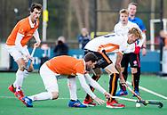 BLOEMENDAAL - Hockey - Bloemendaal-Oranje Rood 3-2. Joep de Mol (Oranje-Rood) met Sander 't Hart (Bldaal)    COPYRIGHT KOEN SUYK