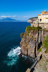 Sorrento, Italy, September 20 2017. A cliff-edge hotel with Mount Vesuvius in the background in Sorrento, Italy. © Paul Davey