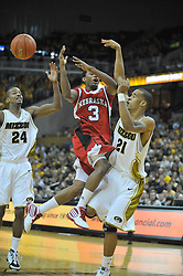 Jan 23, 2010; Columbia, MO, USA; Missouri Tigers forward Laurence Bowers (21) deflects the ball from Nebraska Cornhuskers guard Brandon Richardson (3) in the first half at Mizzou Arena in Columbia, MO. Missouri won 70-53. Mandatory Credit: Denny Medley-US PRESSWIRE