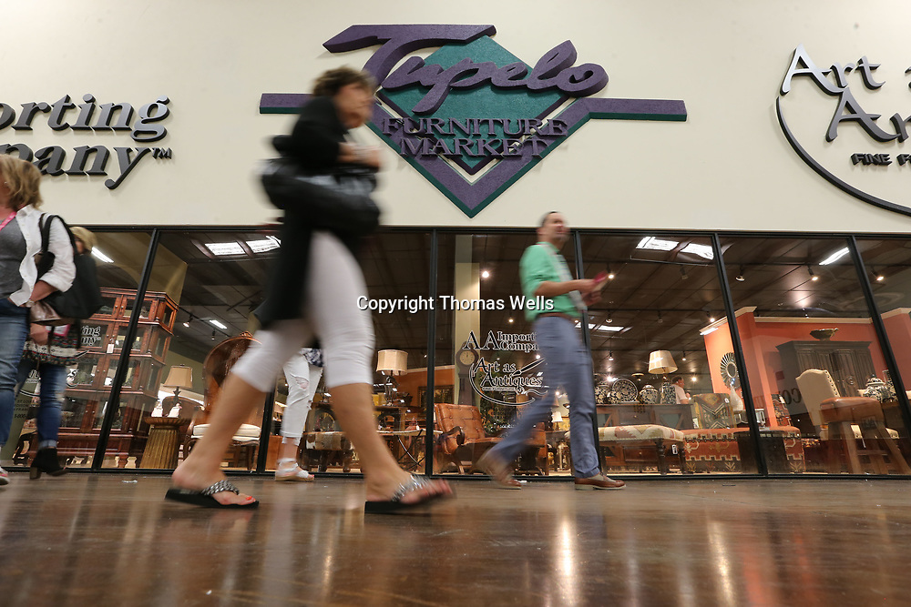 Buyers make their way around the Tupelo Furniture Market on Wednesday looking for deals.