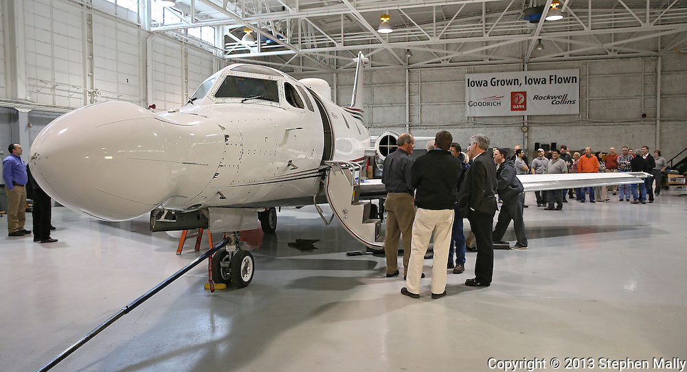 Current and former Rockwell Collins employees say goodbye to their Sabreliner 50 test aircraft at the Eastern Iowa Airport on Wednesday, January 23, 2013.