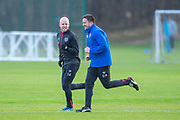 Steven Naismith (#14) of Heart of Midlothian runs with physio Craig Maitland (blue jacket) during training, ahead of the visit of Rangers in the Scottish Premiership on 1st December 2018, at Oriam Sports Performance Centre, Riccarton, Scotland on 30 November 2018.
