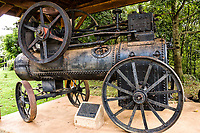 Antiga máquina a vapor ao lado do portal. Saudades, Santa Catarina, Brasil. / <br /> Old steam machine next to the city portal. Saudades, Santa Catarina, Brazil.