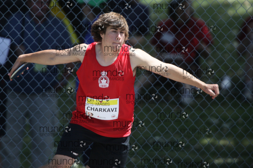Ottawa, Ontario ---10-08-07--- Charkavi competes in the discus at the 2010 Royal Canadian Legion Youth Track and Field Championships in Ottawa, Ontario August 7, 2010..GEOFF ROBINS/Mundo Sport Images.