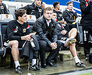 MK Dons manager Karl Robinson watches from the away bench during the Sky Bet Championship match between Brighton and Hove Albion and Milton Keynes Dons at the American Express Community Stadium, Brighton and Hove, England on 7 November 2015. Photo by Bennett Dean.
