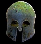 Bronze Helmet (Corinthian) Ancient Greek Circa 600 BC.  Shows repair over a hole.