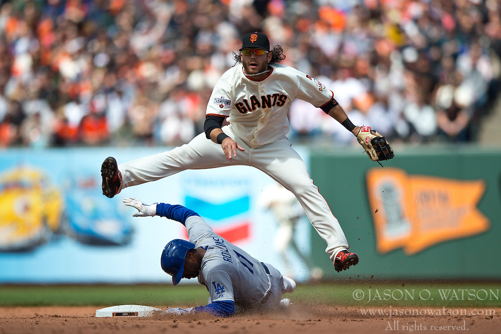 SAN FRANCISCO, CA - MAY 21: Brandon Crawford #35 of the San Francisco Giants completes a double play over Jimmy Rollins #11 of the Los Angeles Dodgers during the eighth inning at AT&T Park on May 21, 2015 in San Francisco, California.  The San Francisco Giants defeated the Los Angeles Dodgers 4-0. (Photo by Jason O. Watson/Getty Images) *** Local Caption *** Brandon Crawford; Jimmy Rollins