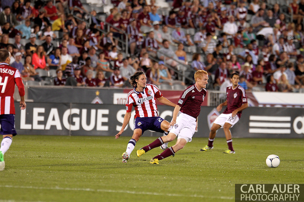 August 18th, 2012: Colorado Rapids midfielder Jeff Larentowicz (4) attempts to get the ball away from the Chivas USA offense in the second half at Dick's Sporting Goods Park