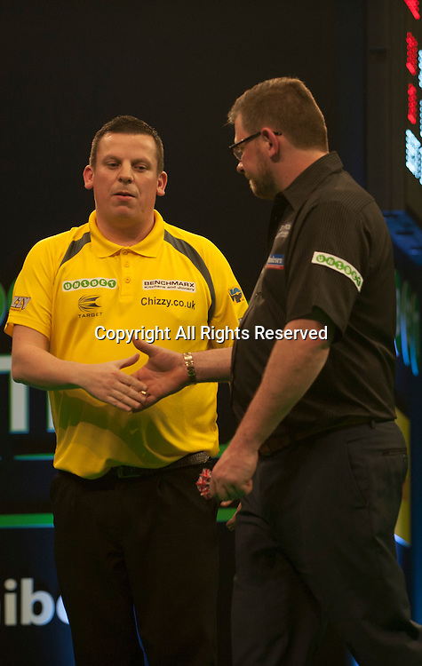 31.01.2016. ArenaMK, Milton Keynes, England. Unibet Masters Darts Championship.  Dave Chisnall [ENG] shakes hands  during his semi final matchwith James Wade [ENG]. Dave Chisnall [ENG] won the match 11-6.