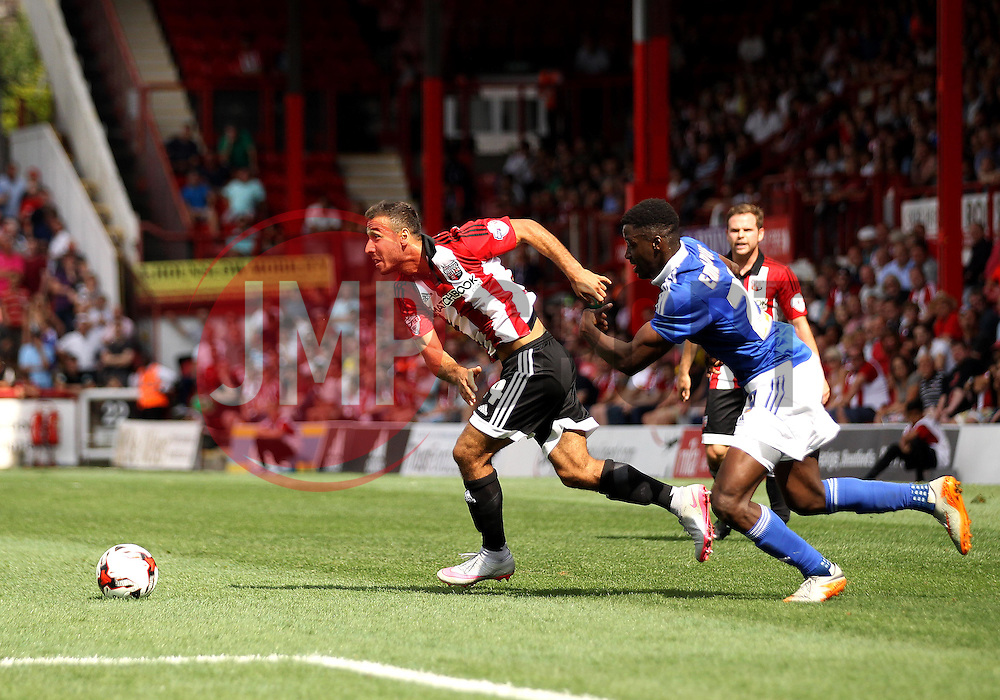 Brentford's Akaki Gogia gets past Ipswich Town's Josh Emmanuel - Mandatory by-line: Robbie Stephenson/JMP - 07966386802 - 08/08/2015 - SPORT - FOOTBALL - Brentford,England - Griffin Park - Brentford v Ipswich Town - Sky-Bet Championship