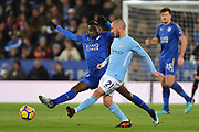 Leicester City midfielder Wilfred Ndidi (25) at full stretch tries to block Manchester City midfielder David Silva (21) during the Premier League match between Leicester City and Manchester City at the King Power Stadium, Leicester, England on 18 November 2017. Photo by Jon Hobley.