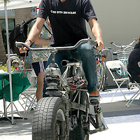 German Artist Martin Kaltwasser rides his  'carcycle' during Santa Monica Public Library's bicycles and cycling  iCycle  festival  on Saturday, May 22, 2010. The carcycle was converted from a Saab 900 Turbo and is entitled, 'Cars Into Bicycles.'
