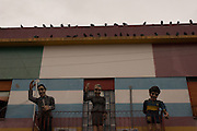 (From left to right) Sculptures of tango singer Carlos Gardel, Argentinean first lady Eva Perón and footballer Diego Maradona can be seen on a balcony of Caminito street, in La Boca neighborhood of Buenos Aires, Argentina.<br /> Caminito is a pedestrian street created in the late 1950s by local painter Benito Quinquela Martín and other artist friends to recreate a version of the old immigrant neighborhood of La Boca, using wood and corrugated zinc painted in bright colors. Today, Caminito and the surrounding areas feature cafes, souvenir shops, tango dancers and other street performances aimed to attract tourists.