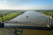 Nederland, Gelderland, Gemeente West Maas en Waal, 24-10-2013; Prins Willem-Alexanderbrug over de Waal bij Beneden-Leeuwen. Tuibrug (gecombineerd met kokerbrug).<br /> Prince Alexander bridge crosses river Rhine (Waal).<br /> luchtfoto (toeslag op standaard tarieven);<br /> aerial photo (additional fee required);<br /> copyright foto/photo Siebe Swart.