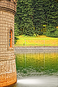 Gatehouse 5 and reflections on Reservoir 5, one of three open reservoirs at Mount Tabor Park and of five total in Portland.  The 3 open reservoirs in Mount Tabor Park, with their  ancillary structures, were placed in the National Register of Historic Places on January 15, 2004.  Environmental Protection Agency (EPA) regulation: Long Term 2 Enhanced Surface Water Treatment Rule, referred to as the LT2 rule imposes new requirements that open water reservoirs be covered, buried or additionally treated.  This applies to Portland's five open reservoirs and to the unfiltered Bull Run source supplying them.