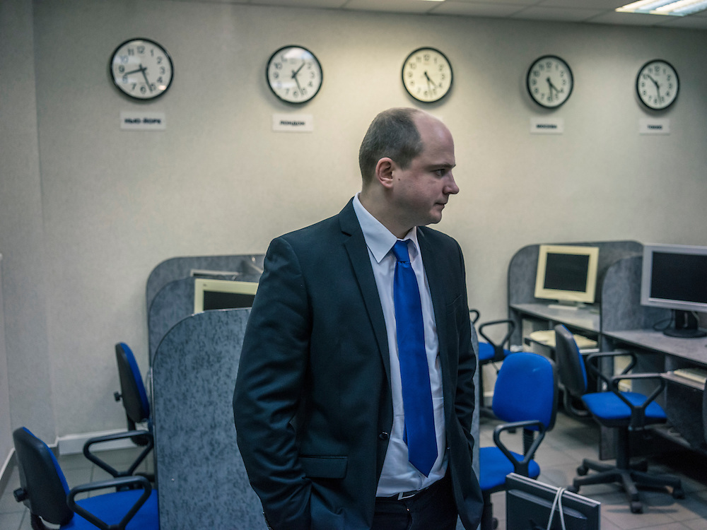 Vitaly Tikhonov, head of the information and analytical department of the Belarus Stock Exchange, inside the empty trading office on Monday, November 23, 2015 in Minsk, Belarus. The office is empty because traders have for the past several years worked remotely.