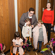 The Temple Israel community celebrates Simchat Torah at Temple Israel on October 4, 2015 in Boston, Masschusetts. (Photo by Elan Kawesch)