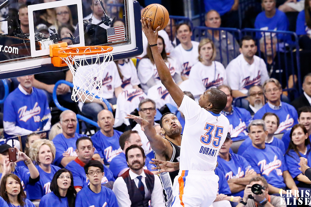 06 May 2016: Oklahoma City Thunder forward Kevin Durant (35) goes for the layup against San Antonio Spurs center Tim Duncan (21) during the San Antonio Spurs 100-96 victory over the Oklahoma City Thunder, during Game Three of the Western Conference Semifinals of the NBA Playoffs at the Chesapeake Energy Arena, Oklahoma City, Oklahoma, USA.