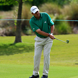 2009 April 26: Matt Bettencourt of Greenville, SC chips onto the green at the seventh hole during the final round of the Zurich Classic of New Orleans PGA Tour golf tournament played at TPC Louisiana in Avondale, Louisiana.