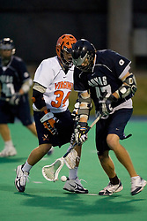 Georgetown Hoyas A Ricky Mirabito (47) and Virginia Cavaliers M Colin Briggs (34)...The Virginia Cavaliers men's lacrosse team faced the Georgetown Hoyas in a Fall Ball Scrimmage held at the University Hall Turf Field in Charlottesville, VA on October 12, 2007.