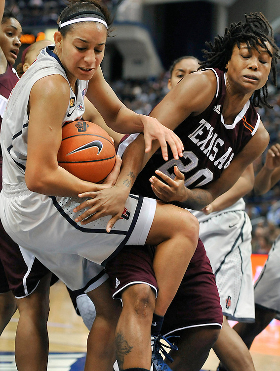 Connecticut's Bria Hartley, left, is guarded by Texas A&M's Tyra White, right, in the first half of an NCAA college basketball game in Hartford, Conn., Tuesday, Dec. 6, 2011.   (AP Photo/Jessica Hill)