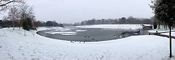 LIVERPOOL, ENGLAND - Friday, January 18, 2013: Sefton Park's Boating Lake is frozen over as the first snow of the winter falls in South Liverpool's Victorian Park. (Pic by David Rawcliffe/Propaganda)