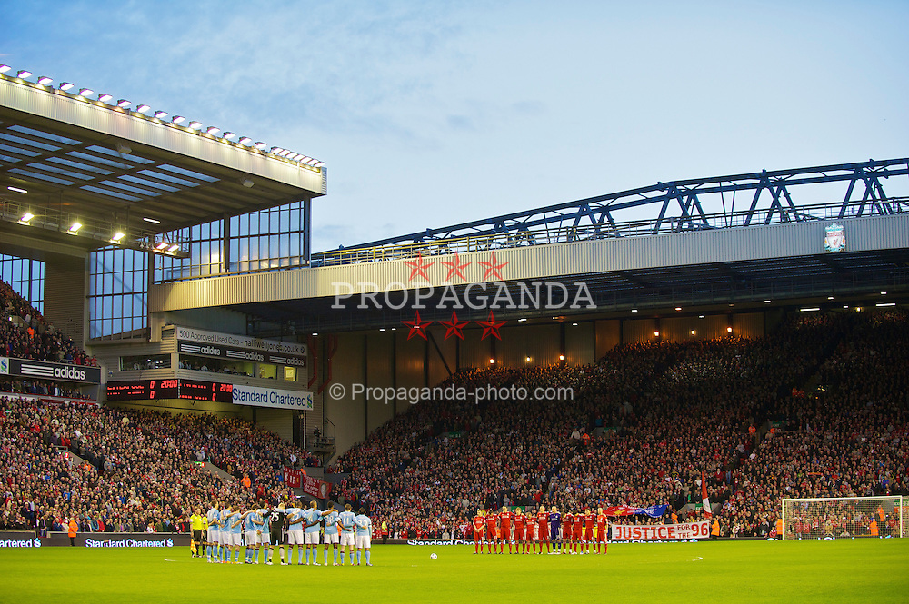 LIVERPOOL, ENGLAND - Monday, April 11, 2011: Liverpool and Manchester City's players and supporters stand to observe a minute's silence to mark the 22nd anniversary of the Hillsborough Stadium Disaster, which claimed the lives of 96 Liverpool fans, before the Premiership match against Manchester City at Anfield. (Photo by David Rawcliffe/Propaganda).