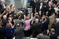 13 FEB 2009, BERLIN/GERMANY:<br /> Angela Merkel (M), CDU, Bundeskanzlerin, zwischen zwei namentlichen Abstimmungen gibt es eine Abstimmung durch Handzeichen, Abstimmungen zum zweiten Konjunkturpaket zur Sicherung von Beschaeftigung und Stabilitaet in Deutschland, Plenum, Deutscher Bundestag<br /> IMAGE: 20090213-01-105<br /> KEYWORDS: Hand aufheben