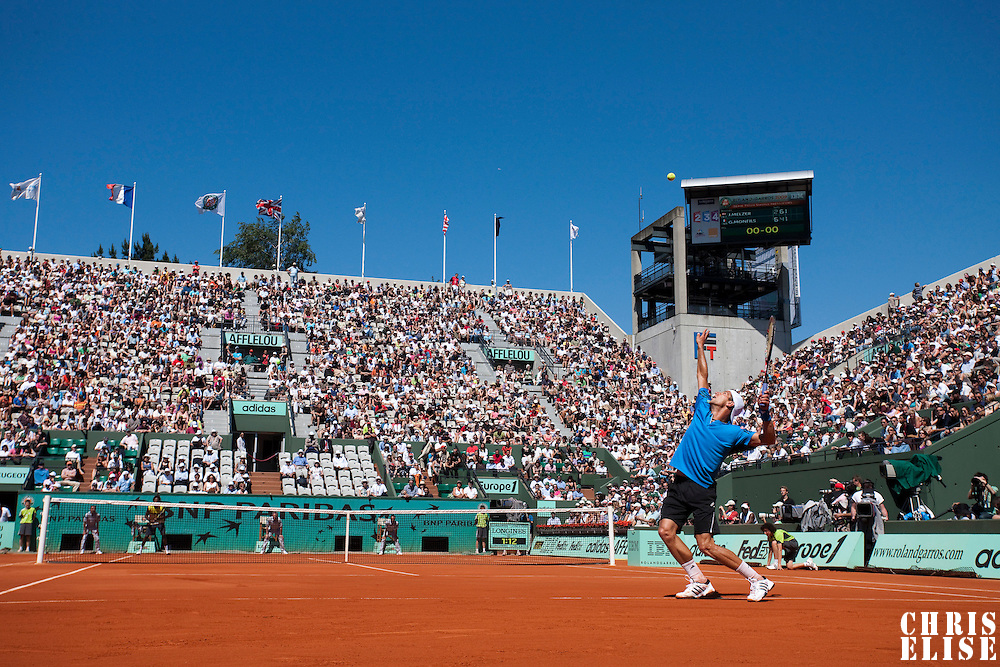 30 May 2009: Jurgen Melzer of Austria serves during the Men's Singles third round match on day seven of the French Open at Roland Garros in Paris, France.