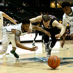 Feb 24, 2016; New Orleans, LA, USA; Tulane Green Wave guard Malik Morgan (13) and guard Von Julien (10) scramble for a loose ball with East Carolina Pirates forward Michael Zangari (34) during the first half of a game at the Devlin Fieldhouse. Mandatory Credit: Derick E. Hingle-USA TODAY Sports