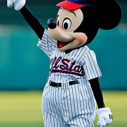 Mar 7, 2013; Lake Buena Vista, FL, USA; Mickey Mouse waves to fans before a spring training game between the Atlanta Braves and the Detroit Tigers at Champion Stadium. Mandatory Credit: Derick E. Hingle-USA TODAY Sports