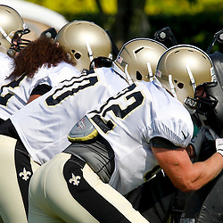 July 29, 2012; Metairie, LA, USA; New Orleans Saints offensive lineman work on a blocking sled drill during a training camp practice at the team's practice facility. Mandatory Credit: Derick E. Hingle-US PRESSWIRE