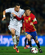 GRANADA, SPAIN - NOVEMBER 12:  David Silva of Spain (R) being followed by Elija Nestorovski of FYR Macedonia (L) during the FIFA 2018 World Cup Qualifier between Spain and FYR Macedonia at  on November 12, 2016 in Granada, .  (Photo by Aitor Alcalde Colomer/Getty Images)