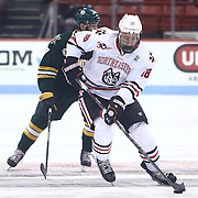 John Stevens #18 of the Northeastern Huskies controls the puck during the game at Matthews Arena on January 18, 2014 in Boston, Massachusetts. (Photo by Elan Kawesch)