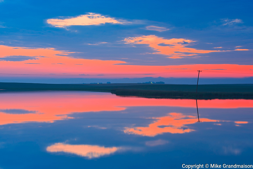 CLouds reflected in wetland at dawn<br />