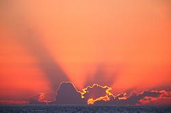 Mexico, Jalisco, Puerta Vallarta. Sun-setting on the Pacific Ocean.
