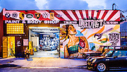 New, hip murals also decorate older Wynwood businesses such as this auto body shop