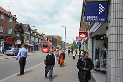 © London News Pictures. 14/07/2013. COPY AVAILABLE BELOW…. General view of Orpington High Street, Kent.  Orpington High street now has 12 charity shops  in one short stretch, with Cancer Research UK having two shops on different sides of the high street almost facing each other.  COPY AVAILABLE HERE:  http://tinyurl.com/nhtxtyd<br /> <br /> Photo credit :Grant Falvey/LNP