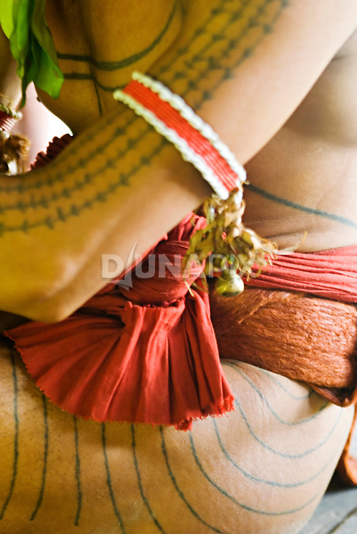 Detail of tattoos, beads and red cloth worn by a Mentawai sikerei (shaman).
