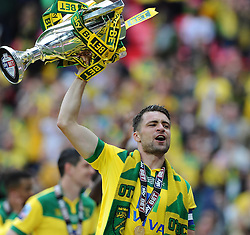 Norwich City captain,  Russell Martin lifts the trophy as Norwich City win promotion to the premier league   - Photo mandatory by-line: Joe Meredith/JMP - Mobile: 07966 386802 - 25/05/2015 - SPORT - Football - London - Wembley Stadium - Middlesbrough v Norwich - Sky Bet Championship - Play-Off Final