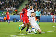 England Forward Daniel Sturridge tackles Slovakia Defender Tomas Hubocan during the Euro 2016 Group B match between Slovakia and England at Stade Geoffroy Guichard, Saint-Etienne, France on 20 June 2016. Photo by Phil Duncan.