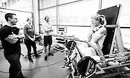 Matt Jordan and Graeme Challis conduct a functional asymmetry assessment on alpine skier Erin Mielzynski in the power lab at the Canadian Sport Institute Calgary facilities in Calgary, Alberta on May 22, 2015.