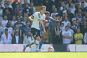 Wilfried Zaha tracks Harry Kane during the Barclays Premier League match between Tottenham Hotspur and Crystal Palace at White Hart Lane, London, England on 20 September 2015. Photo by Alan Franklin.